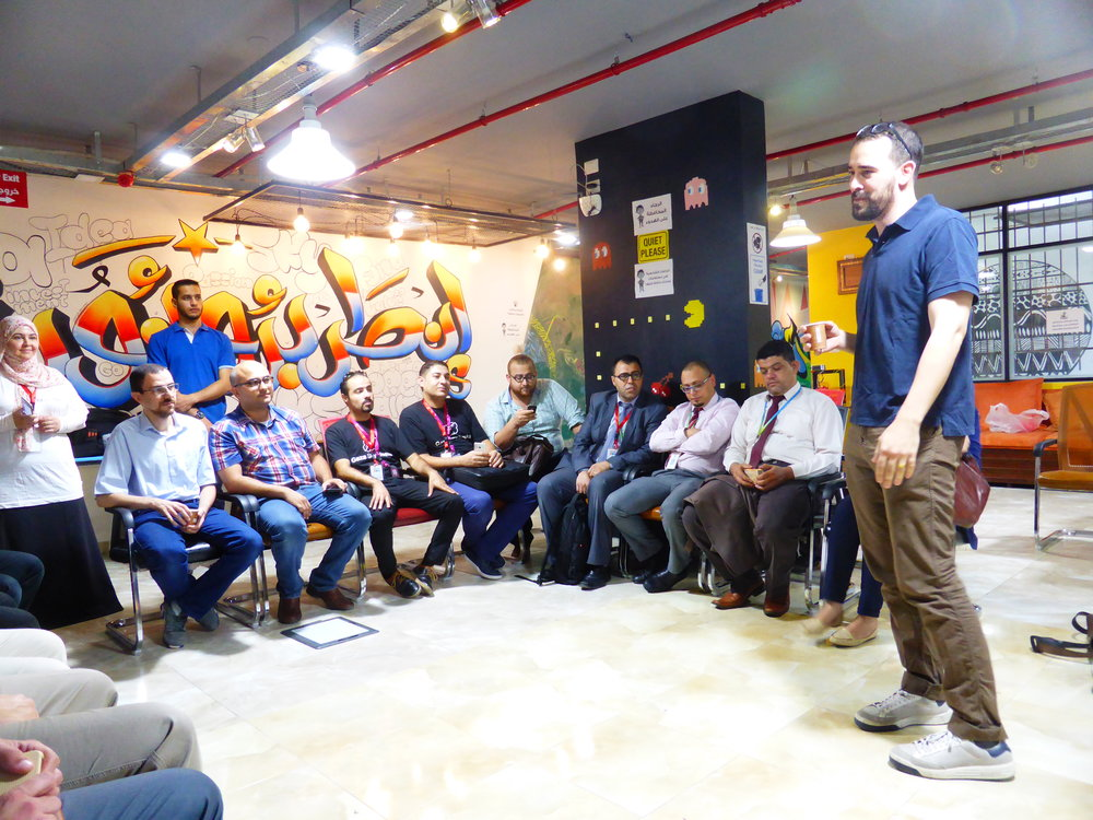 Ryan chairing a breakfast meeting for all the actors in Gaza's tech ecosystem at the GSG offices
